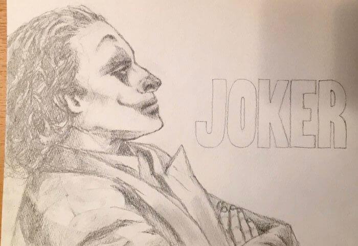 映画ジョーカー考察、鉛筆画。ホアキンのメイク写真を模写